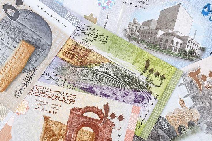 ارتفاع بسيط لليرة السورية أمام الدولار الأمريكي.