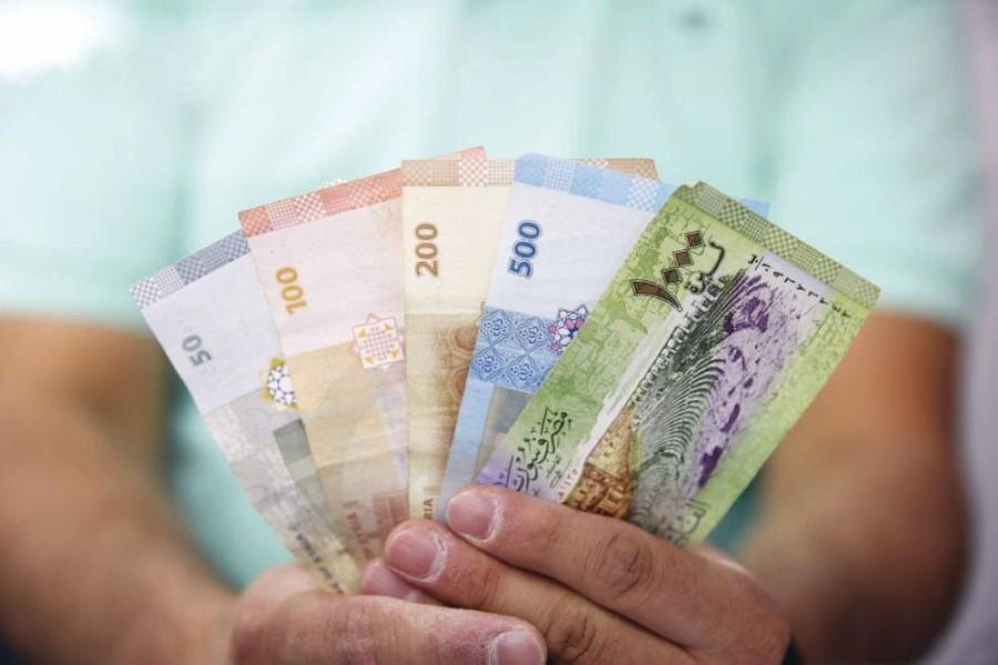الليرة السورية تحقق مكاسب مقابل الدولار الأمريكي
